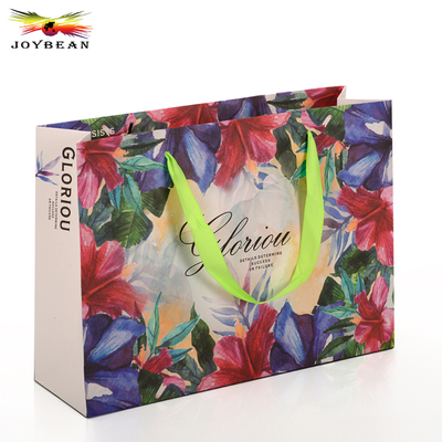 Colorful paper bag with handle ribbon